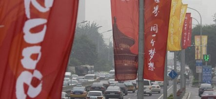 China asks German firms to halt production before Olympics