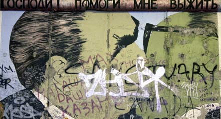 Artists give Berlin Wall murals anniversary makeover