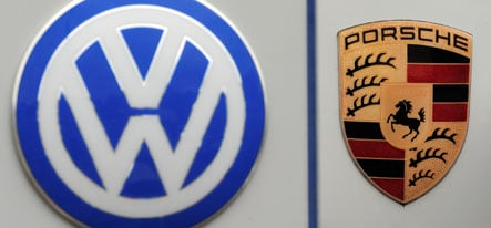 Overstretched Porsche agrees to VW merger
