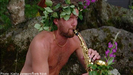 Naked horn player named Sweden's Water Fairy of the Year