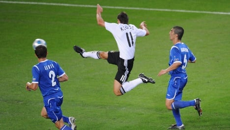 Two goals by Klose keep Germany headed for World Cup