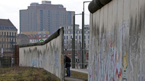 Workers restoring watchtower to stretch of Berlin Wall