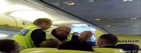 Boxers pin passenger in mid-air scare