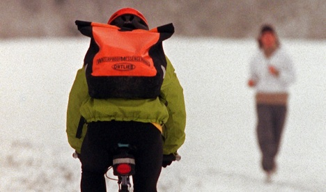 Bike couriers grappling with enduring snow and ice