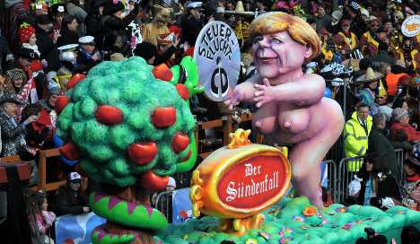 Karneval floats feature giant Obama, naked Merkel and zombie bankers