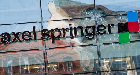 Axel Springer merges eastern holdings with Swiss group
