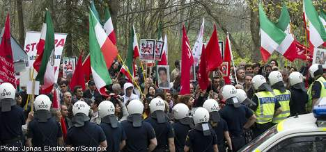 Protestors try to storm Iranian Embassy