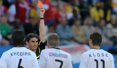 Serbia sink 10-man Germany as cards fly