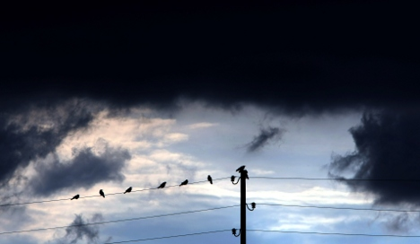 Storm warnings issued as mercury climbs
