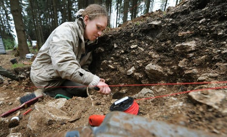 Archaeologists expect Roman weapons, find live WWII grenades