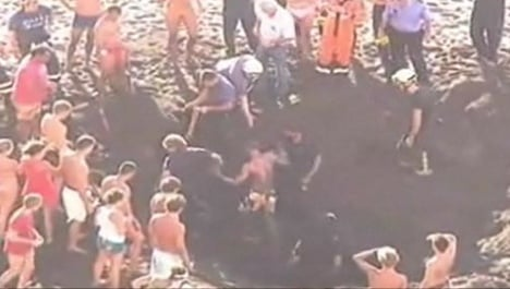 German tourist rescued from self-dug hole on Spanish beach