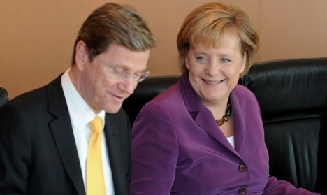 Westerwelle mends differences with Merkel
