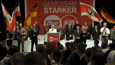 Neo-Nazi NPD votes to join forces with smaller right-wing party