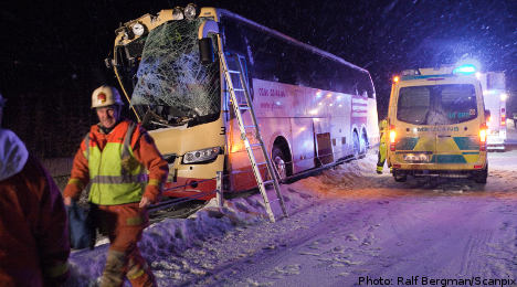 Several injured as coach collides with truck