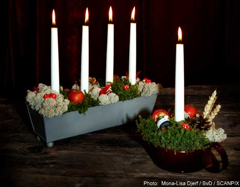 Swedes turn to candles to thwart the darkness