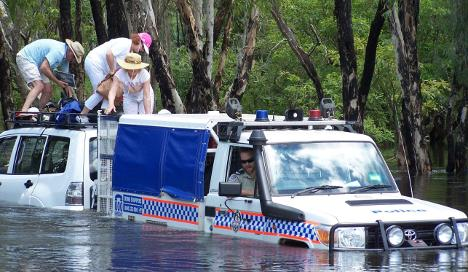 Tourists rescued from croc-infested Aussie river