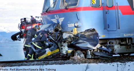 Two dead after Swedish train crushes taxi