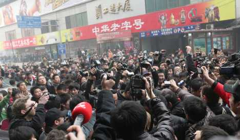 Journalists held in China over protest reports
