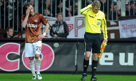 St Pauli faces fine and ban after linesman hit from stands