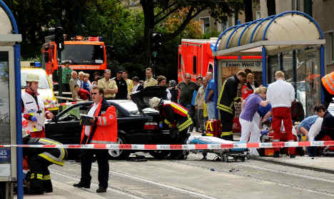 Car ploughs into crowd injuring 11 people