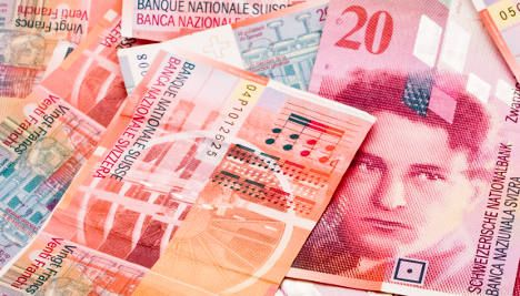 Swiss franc drops on UBS fee announcement