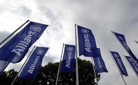 Insurer Allianz results bow to Greek losses