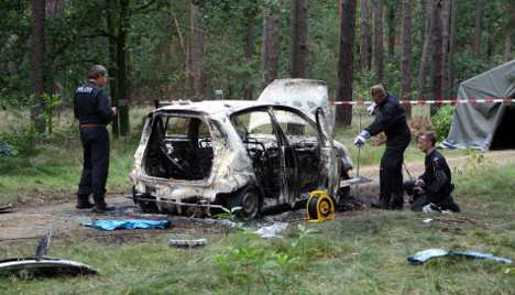 Police probe family tragedy after two girls found dead in burned car