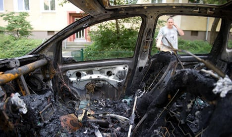 Cars burn in Berlin for second night in a row