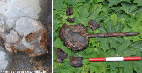 Dig reveals human skulls mounted on stakes