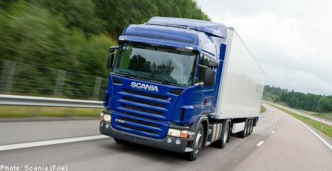 Scania cuts output amid slowing global growth