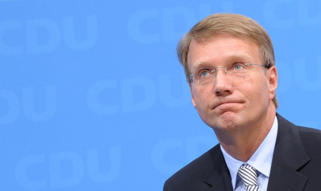 Merkel man's apology fails to quell party unease