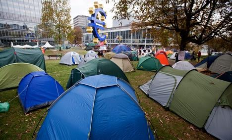 Anti-capitalist protesters set up tent cities