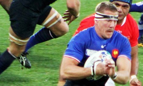 Rugby star's dad sorry for on-pitch rumpus