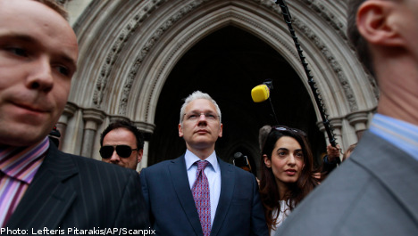 Assange cleared to continue extradition fight