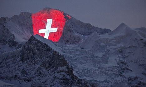 Iconic Swiss mountain lights up for first train ride