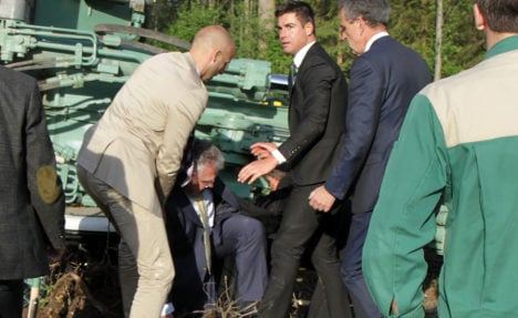 Red-faced politician stuck in ceremony digger