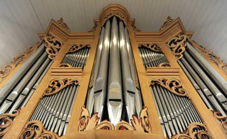 Organist fired for 'living in sin' wins payout