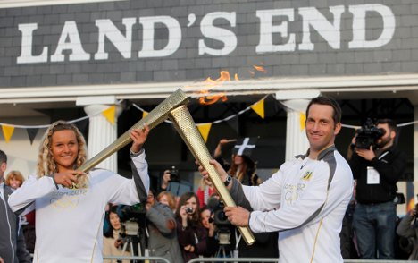 Olympic torch sponsor sends execs as runners