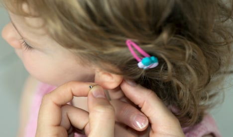 Judge questions legality of child ear-piercing