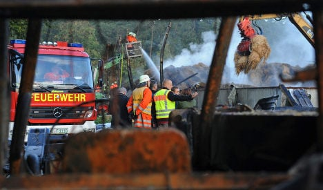 Police find girl's body after hay barn fire