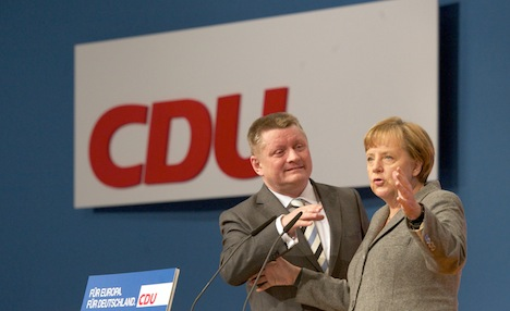 Merkel seeks to rally her conservatives for vote