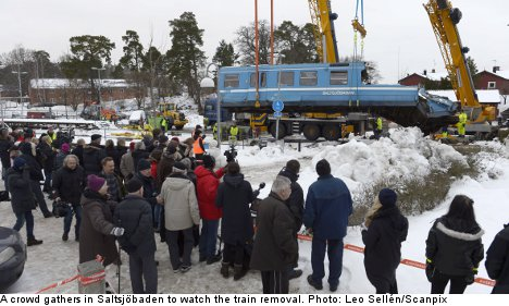 Crashed train removed from Stockholm house