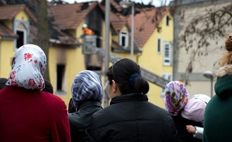 Germany and Turkey mourn eight fire victims