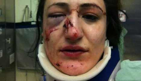 Cop faces charges for punching woman