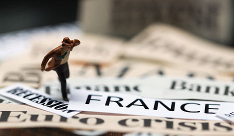France to cut spending for first time since 1958