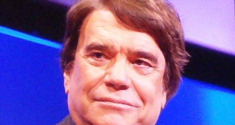 French tycoon Tapie held over corruption scandal