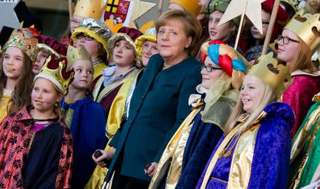 Merkel appears at carol concert on crutches