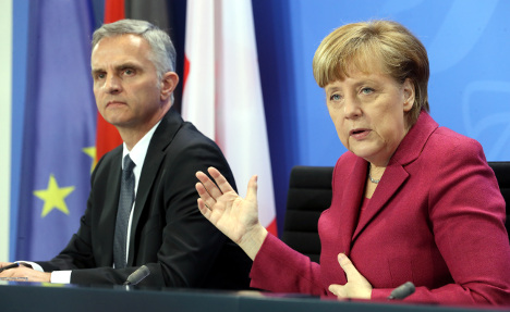 Merkel comes to Swiss defence over poll