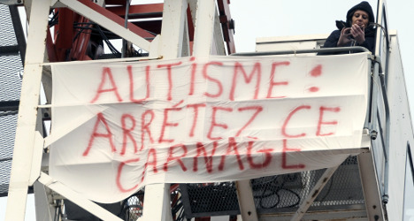 Protesting mother on perch above French city