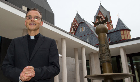 'Bling Bishop' moves into luxury Bavarian flat